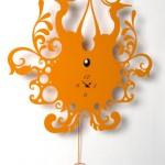 Dekoratif turuncu renkli duvar saati
