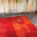 Kırmızı turuncu karışımı modern yer halısı